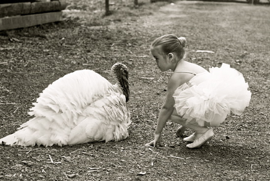 girl-with-turkey-friend-vegan-thanksgiving Photo by Woodstock Farm Animal Sanctuary